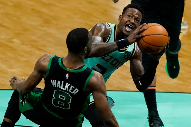 Charlotte Hornets guard Terry Rozier drives to the basket over Boston Celtics guard Kemba Walker during the first half of an NBA basketball game on Sunday, April 25, 2021, in Charlotte, N.C.