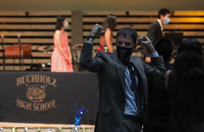 Will Frazer, advisor for the Buchholz math team, celebrates after his team received a first-place award during the livestream of the 2021 Mu Alpha Theta Florida State Championship awards. [Lauren Witte/Special to the Sun]