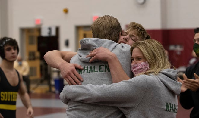 Ty Whalen hugs his mom and dad  James and Liz after winning. Clearview Regional Ty Whalen defeats  Don Bosco Prep Kelly Dunnigan 2-1 in their 132 lbs final. NJSIAA State Wrestling Championships at Phillipsburg High School on April 24, 2021.