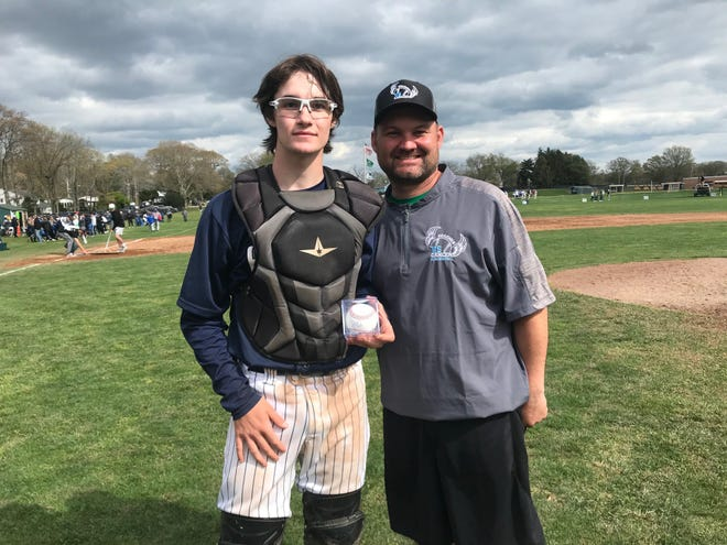 St. Augustine's Austin Sofran, left, is presented a Mike Trout autographed baseball for being named Player of the Game in a 7-3 triumph over Gloucester Catholic at the Coaches vs. Cancer Classic at Mainland on Sunday.
