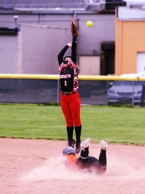 Carah Mladek, of Ridgewood, slides into second base as Coshocton's Keeley Murray leaps to catch a throw during their doubleheader in Coshocton. Both were first-team selections as the East District Softball Coaches Association released their teams.