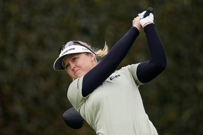 Brooke M. Henderson tees off from the first fairway during the final round of the LPGA's Hugel-Air Premia LA Open golf tournament at Wilshire Country Club Saturday, April 24, 2021, in Los Angeles.