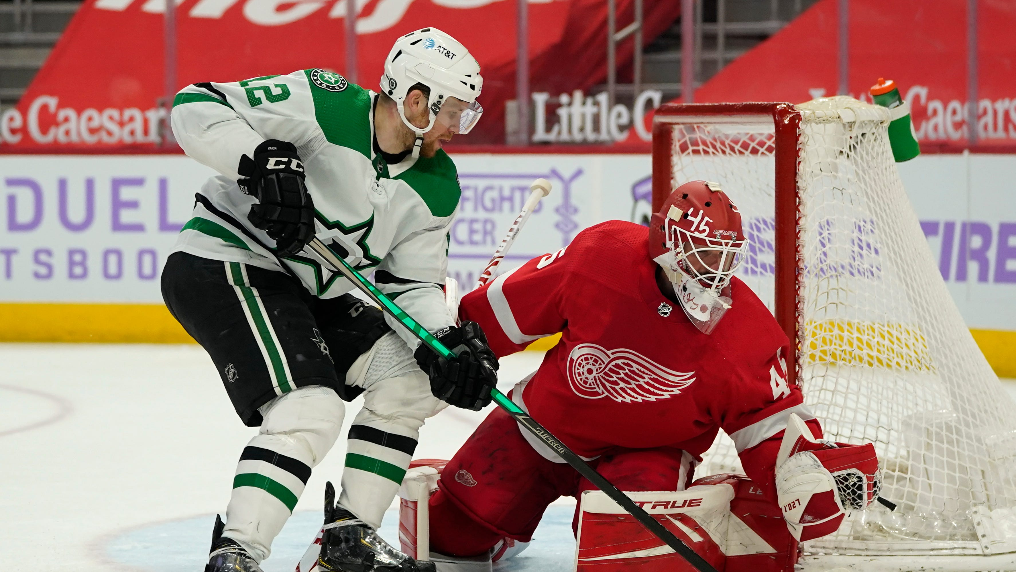 Detroit Red Wings goaltender Jonathan Bernier (45) stops a Dallas Stars center Radek Faksa (12) shot in the third period of an NHL hockey game Saturday, April 24, 2021, in Detroit.