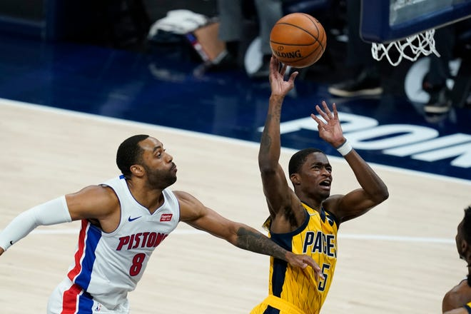 Indiana Pacers' Edmond Sumner (5) is fouled by Detroit Pistons' Wayne Ellington (8) as he goes up for a shot during the second half of an NBA basketball game, Saturday, April 24, 2021, in Indianapolis. (AP Photo/Darron Cummings)
