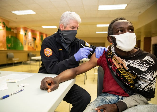 Mark Johnson, a lieutenant in the Memphis Fire Department, administers the COVID-19 Johnson & Johnson vaccine to Jerrico Young at Calvary Episcopal Church on Sunday, April 25, 2021.