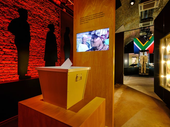 'Mandela: The Official Exhibition' displays moments in the life of Nelson Mandela, including a ballot box and videos to represent when Black South Africans, voting for the first time, elected Mandela to be South Africa's first Black president.