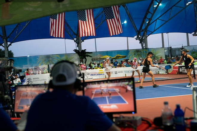 Commentators for the CBS Sports Network watch the women's pro doubles final during the U.S. Open Pickleball Championships at East Naples Community Park on Saturday, April 24, 2021.