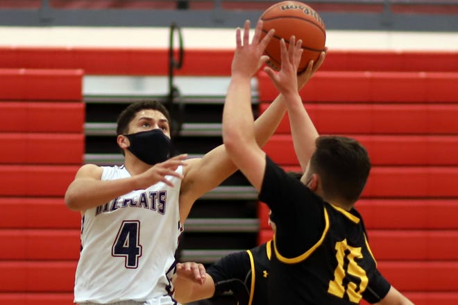 Senior Wildcat Jonathan Caballero (4) takes a hard drive to the basket during Thursday's home loss against Alamogordo.