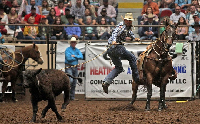 Caleb Smidt competes in the tie down roping event during the Cinch Chute-Out at the San Angelo Rodeo on Saturday, April 24, 2021.