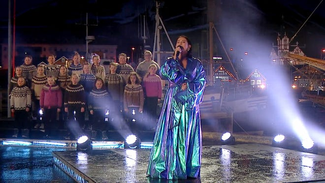 """Molly Sandén performs """"Husavik"""" with a choir of sweater-clad kids in Iceland for the Oscar night pre-show."""