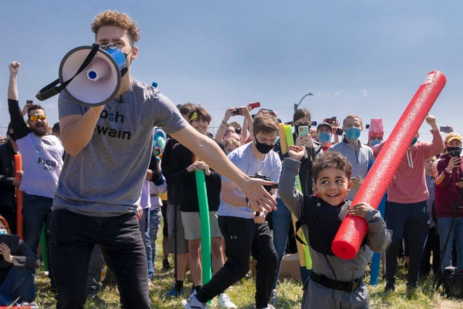 Josh Swain, left, declares Lincoln native four-year-old Joshua Vinson Jr., right, the ultimate Josh after the Josh fight took place in an open green space at Air Park on Saturday, April 24, 2021, in Lincoln, Neb. What started as a mid-pandemic joke took on life Saturday, as a mixed bag of individuals sharing only their name came to battle it out. The winner was to be declared the rightful owner of the name.