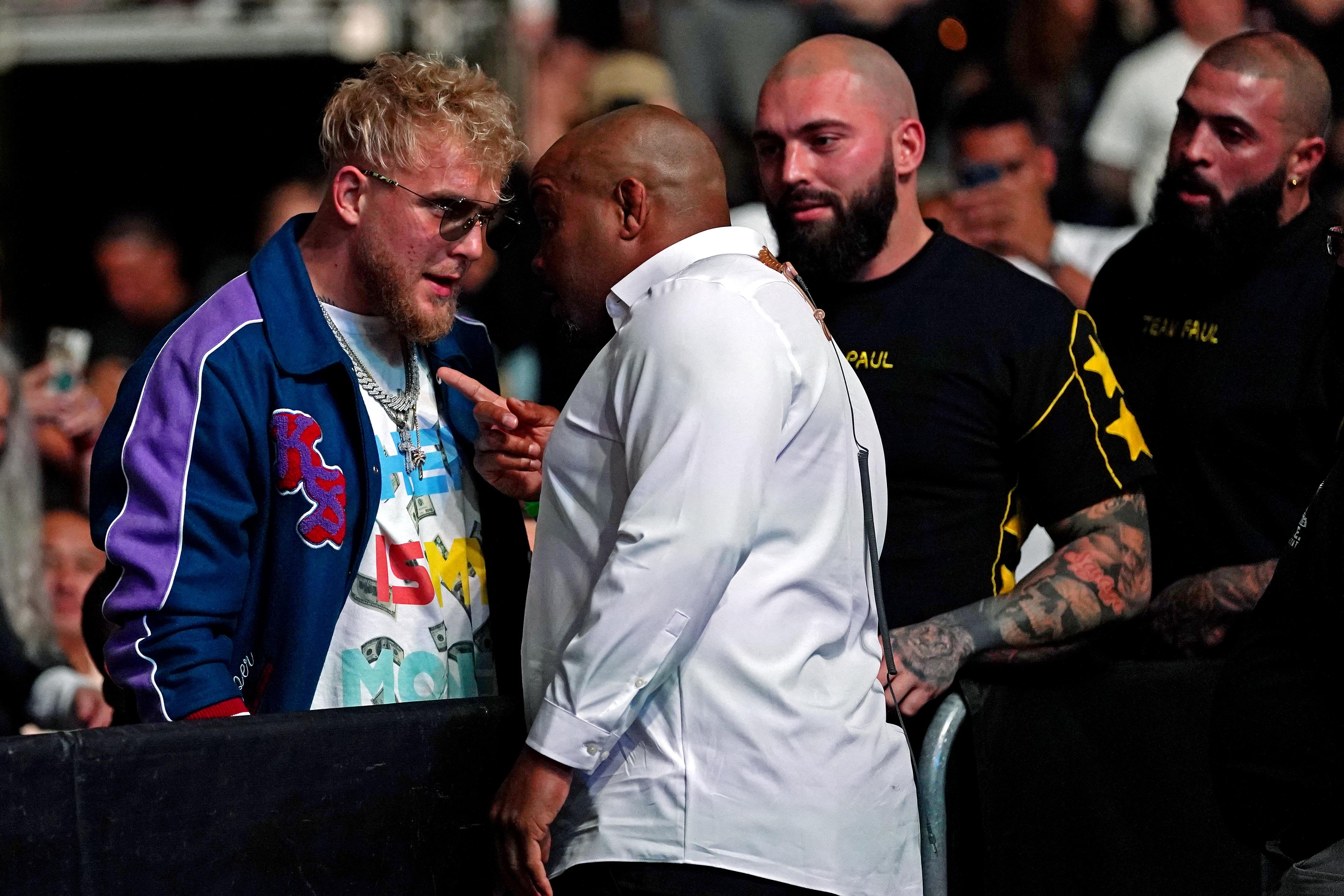 Watch: Daniel Cormier confronts Jake Paul in crowd at UFC 261