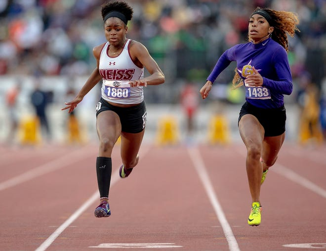 Weiss sprinter Michaela Francois, left, outraces Fort Worth Chisholm Trail sprinter Deja Shaw Huckaby in the 100-meter dash while winning the gold medal during the 2019 UIL state track and field meet. Francois won the Class 5A Region III 100 finals and will get a chance to defend her title at the Class 5A state meet  May 7 at Myers Stadium on the University of Texas campus.