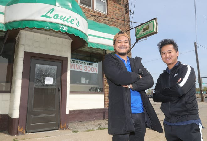 """Rajesh """"Raj"""" Gurung, left, and his partner Chakra Gurung plan to reopen Louie's Bar & Grill, complete with its famous burgers, as well as Nepali and Indian cuisine."""