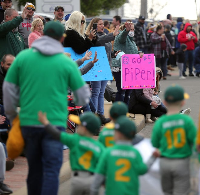 Hundreds of parents and family members lined the sidewalks on West Avenue to watch their baseball players walk by during the Tallmadge Little League parade, Sunday, April 25, 2021, in Tallmadge, Ohio. [Jeff Lange/Beacon Journal]