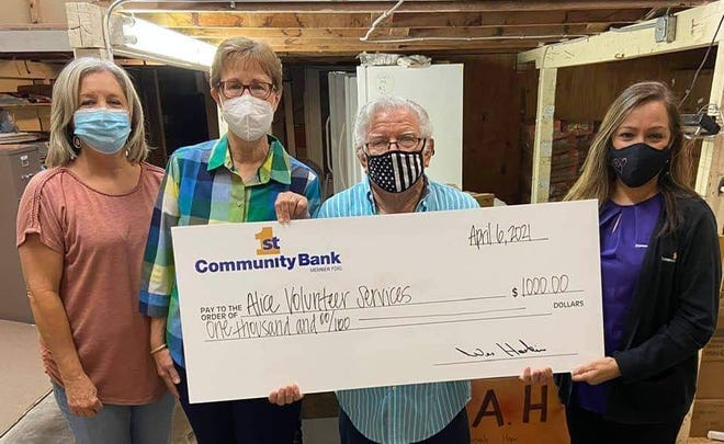 First Community Bank awards $1,000 check to Alice Volunteer Services.
