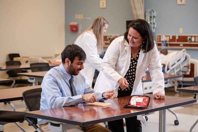Physician Assistant Studies student Mayar Patel gets some tips on suturing from program director Melissa Irwin. Patel is a member of Ashland University's inaugural PA Studies class, which will begin classes this fall.