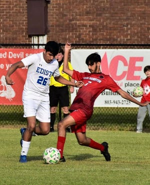 Shiv Patel (at right) maneuvers around an Edisto opponent during Wade Hampton's shut-out victory.
