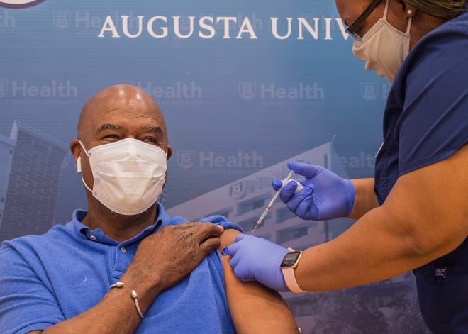 Augusta Commissioner Ben Hasan gets his COVID-19 vaccination Monday at Augusta University's new vaccination clinic at Diamond Lakes Park in Hephzibah.