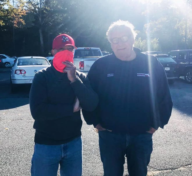 Rep. Steve Xiarhos (R-West Barnstable), left, and Don Cox, president of the Massachusetts Military Support Foundation, onsite at 4Cs emergency food distribution last autumn.
