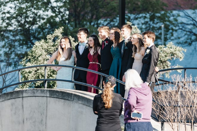 Family members oversee the perfect prom portrait in the Phillips Plaza in downtown Bartlesville on Saturday, April 24.