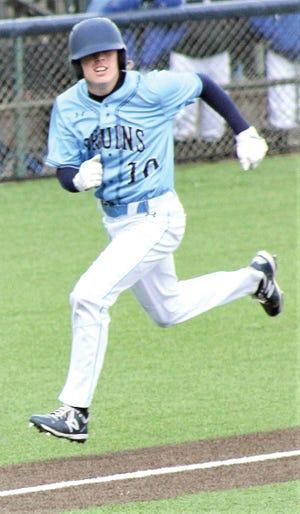 Hayden Catlin gallops toward home plate during Bartlesville High School home baseball action.