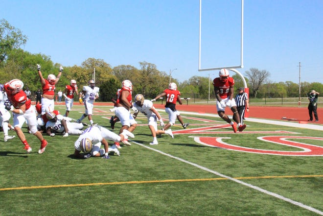 Coffeyville's Star Thomas (18) scores in the fourth quarter against Butler on Sunday, April 25 at Veteran Memorial Stadium in Coffeyville, Kansas. Thomas finished with four touchdowns on the afternoon.
