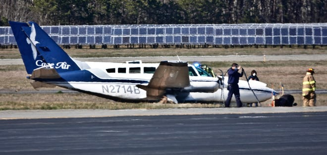 A Cape Air Cessna 402 sits off the runway Monday at Cape Cod Gateway Airport after the plane experienced engine failure during a training flight.