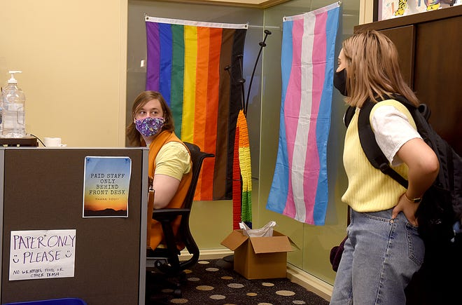 Ray Jude Tubbs, left, a University of Missouri student who serves as history and archiving coordinator at the LGBTQ Resource Center on campus, talks with Ael Diehm, student mental health coordinator, on Monday at the center. Some MU professors are calling for the halting of plans to restructure social justice centers on campus.