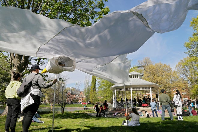 """Motherful, a """"mom-profit"""" based in Gahanna, brought a large peace dove to a demonstration of about 200 people who demanded justice for Ma'Khia Bryant at Goodale Park in Columbus on Sunday."""