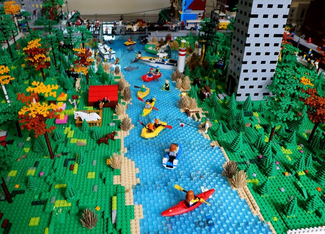 Boaters floating on a river is part of a large LEGO display at the Columbus Museum of Art that includes Downtown buildings.