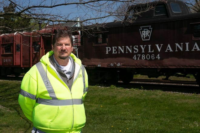 Mark Arnold, Telecommunications Director for Kutztown, poses for a portrait in front of the historic train station in Kutztown, Pa. on Friday, April 23, 2021. President Joe Biden's $2 trillion infrastructure plan aims to expand internet access by building more publicly-owned broadband networks. Kutztown runs one of 200 city-wide broadband networks across the country that offer internet service. (HEATHER KHALIFA/The Phildadelphia Inquirer/TNS)
