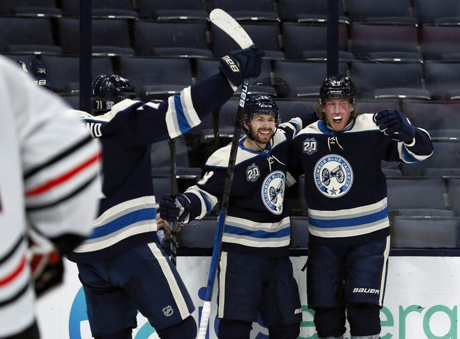 """The Blue Jackets' Oliver Bjorkstrand, center, here celebrating his goal with Patrik Laine, right, and Nick Foligno on Feb. 23, says, """"You don't want to be in a bad mood the whole day, so I think guys just have to lift each other up by joking around when we can."""""""