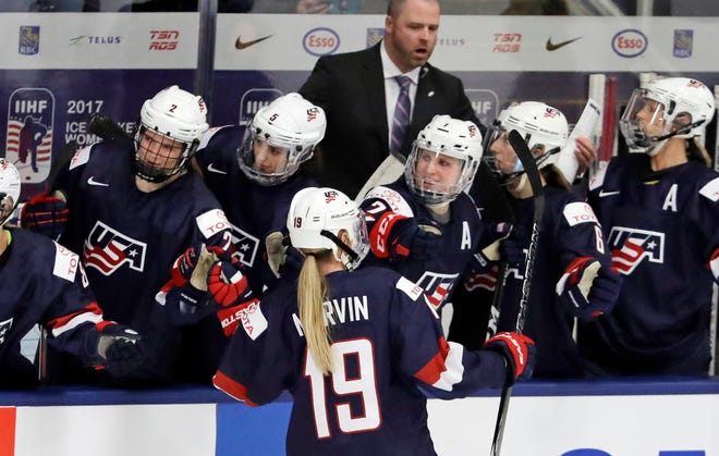United States forward Gigi Marvin is congratulated by teammates after scoring against Canada at the IIHF Women's World Championship in 2017.