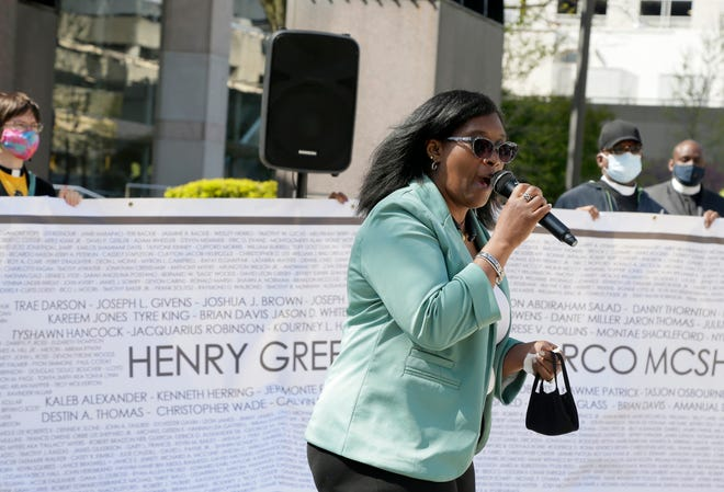 Adrienne Hood, whose son Henry Green was killed in 2016 by plainclothes Columbus police officers, speaking near the Columbus Division of Police headquarters in Downtown Columbus in April.