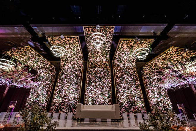 A stunning floral wall reception installment designed by B3 Event Management for Alekhya and Justin Shum