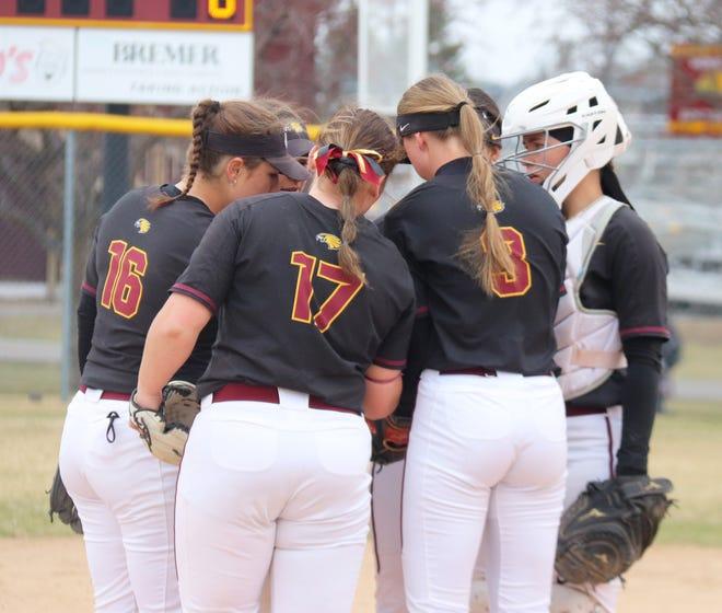 The Minnesota Crookston softball team huddles during a game against Minnesota State on April 25.