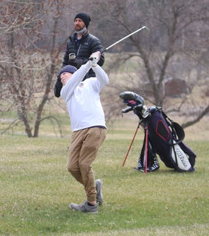 Garrett Fischer shoots from the rough during the Pirate Invitational at Minakwa Golf Course on April 26. Fischer and the Crookston boys' golf team recorded two fifth-place finishes this weekend in Thief River Falls and Roseau.