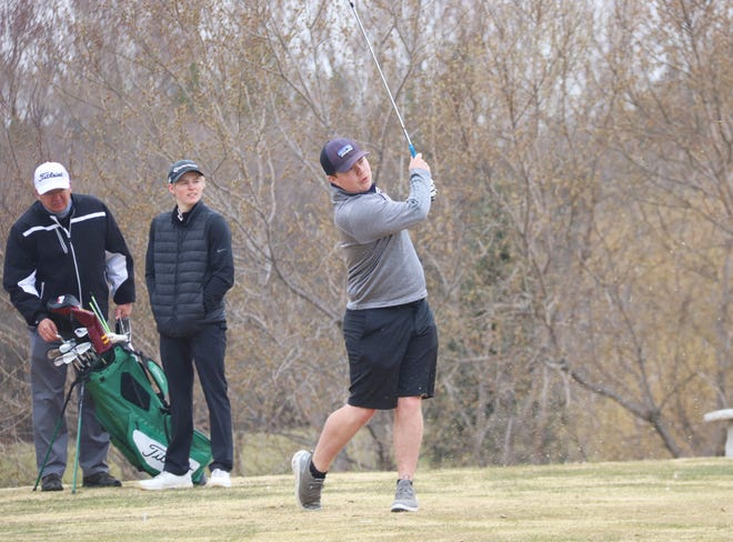 Jaxon Wang watches his shot during the Crookston Invitational on April 26 at Minakwa Golf Course. Wang carded a 94 at the East Grand Forks Invitational on Tuesday.