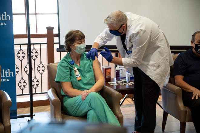 A healh care worker receives a COVID-19 vaccine at the UF Villages Hospital. [Cindy Peterson/Correspondent]