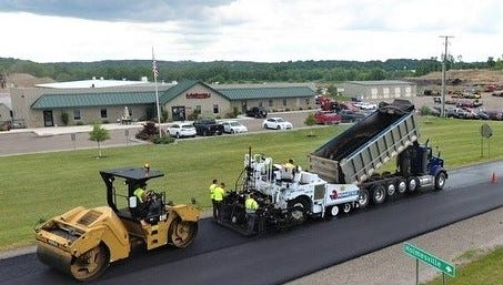 A Melway Paving crew resurfaces the road outside of Melway Paving office near Holmesville last year. Melway Paving was awarded the contract for Holmes County's 0.25 percent Sales Tax County Road Paving Project.
