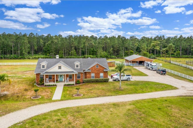 This nearly 12-acre property in a USDA area of New Smyrna Beach has lots to offer, including a six-stall barn and five fenced pastures and riding trails on the back part of the property.