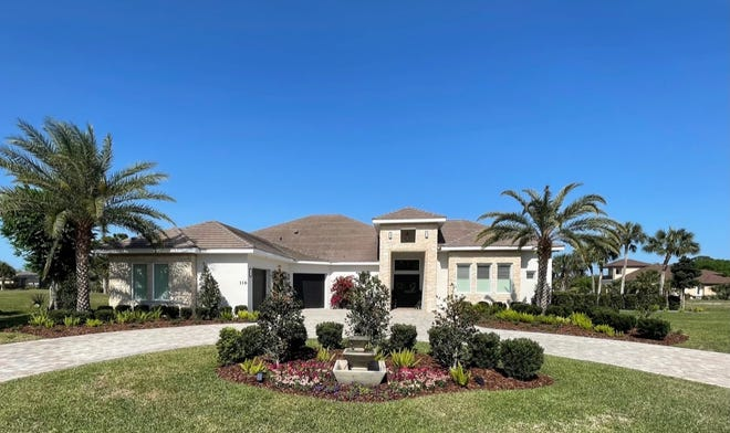 A paver-covered circular driveway leads up to this beautiful lakefront home in one of Ormond Beach's most sought-after subdivisions on the scenic Loop.