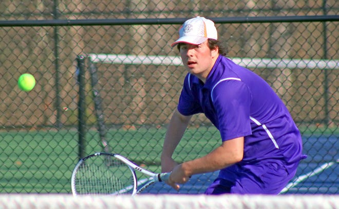 Wallenpaupack Area junior Anthony Marie sends a volley back across the net against Delaware Valley. The Buckhorns earned a hard won 3-2 victory over the Warriors last Friday at home.