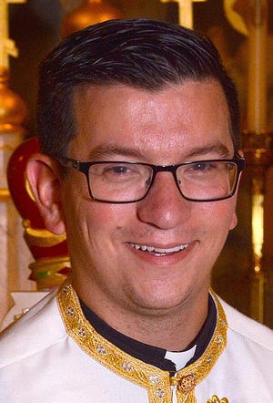The Rev. Nicholas Mihaly is the parish priest at St. Nicholas Orthodox Church, 1123 East Ave.