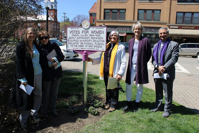 Alfred University Provost Beth Ann Dobie, Professor Sociology Karen Porter, Professor of Theater Becky Prophet '70, Archivist Laurie Lounsberry Meehan '91, and President Mark Zupan celebrate the unveiling of the plaque honoring the life and contributions of Abigail Allen, who taught at the University for more than 50 years and was the wife of the University's second president, Joanathan Allen.