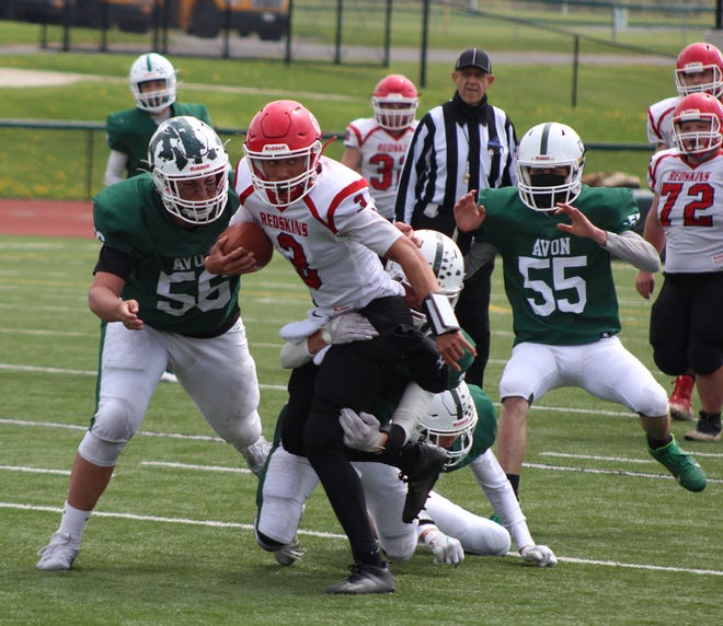Roque Santiago (3) breaks a tackle during Sunday's contest against Avon in the Section V Class D Playoffs in Avon.
