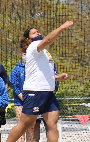 William Chrisman senior Jacque David competes in the discus in the Liberty North Invitational Saturday. David set the meet record with a toss of 40.14 meters and also won the shot put with a meet record heave of 12.42 meters.