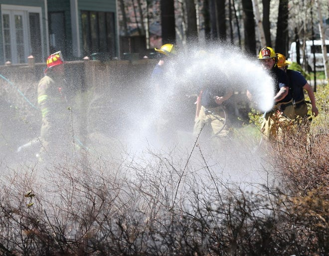 Dover firefighters were able to quickly extinguish a two-alarm brush fire in Dover on Monday morning.