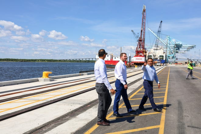 JaxPort Chief Operating Office Fred Wong, at right, shows the Blount Island terminal to Puerto Rico Ports Authority Executive Director Joel Piza Batiz, in middle, and Romel Pedraza, assistant executive director for planning, engineering and construction at the Puerto Rico authority.